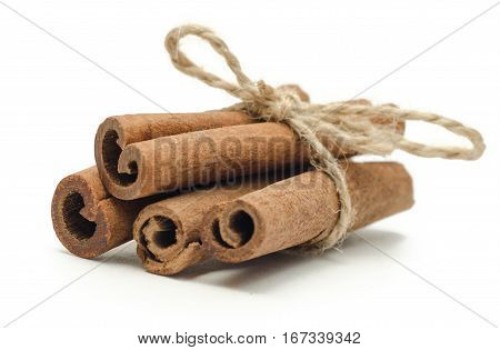 4 cinnamon close up isolated on white background When cinnamon is dried