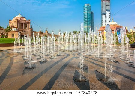 Abu Dhabi, United Arab Emirates - April 21, 2013: Splash of water outside of Emirates Palace Hotel. Emirates Palace is a luxurious and the most expensive 7 star hotel with its own marina and helipad.