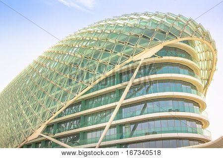 Abu Dhabi, UAE - April 22, 2013: unique glass architecture of Yas Viceroy on Abu Dhabi's Yas Island. The 5-star luxury Resort Hotel is located on Yas Marina Circuit, the racetrack for Formula 1.