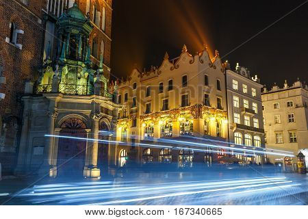Krakow, Poland - January 22, 2017: Carriage Light Trails Before The Mariacki Church On The Main Mark