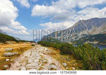 Tatra Mountains, Poland - September 10, 2017: Group Of People Hiking In Five Lakes Valley In High Ta