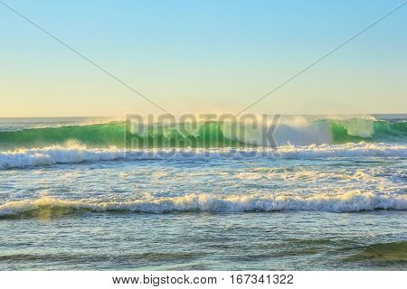 Big waves in Noordhoek Beach, Atlantic coast. Surfing in Table Mountain National Park near Cape Town, South Africa. Extreme sports leisure concept. Powerful waves background.