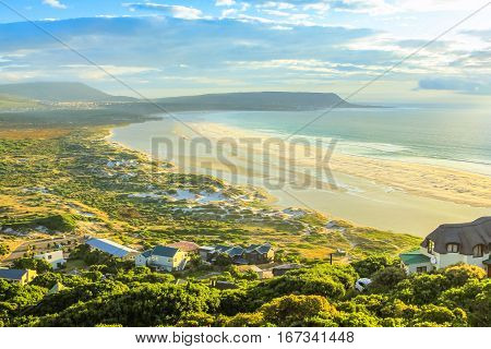 Aerial view of Noordhoek Beach, Table Mountain National Park, South Africa at sunset. Noordhoek Beach, 8 km of sandy beach from Chapmans Peak Drive to Kommetjie and Slangkop Lighthouse.