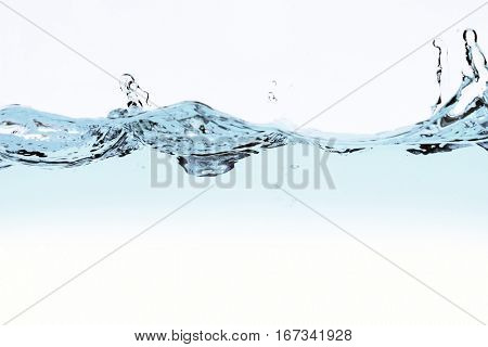 water wave and bubbles over white background
