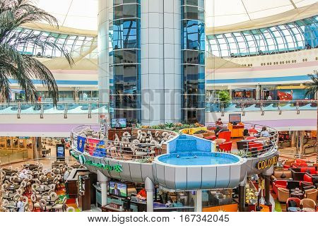 Abu Dhabi, UAE - April 21, 2013: inside of Marina Mall, arranged over four levels and an observatory, is one of the biggest shopping mall in Abu Dhabi close to Emirates Palace hotel.
