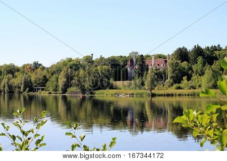 The landscape with lake and castle's reflection