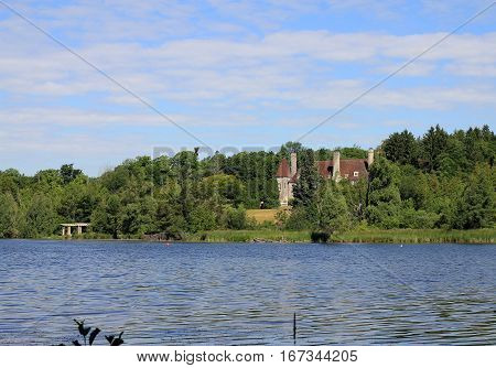 The summer landscape with lake and castle
