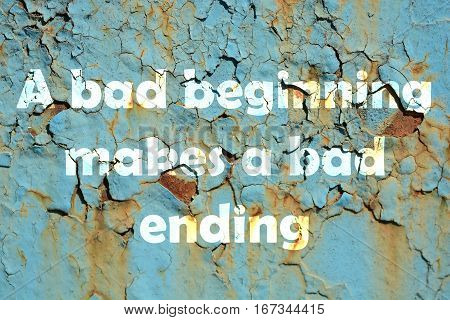 A bad beginning makes a bad ending. words print on the grunge metallic wall