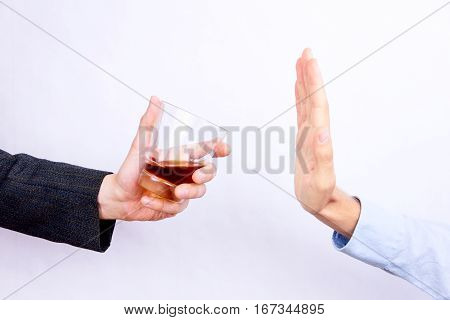 Rejecting Glass Of Whisky