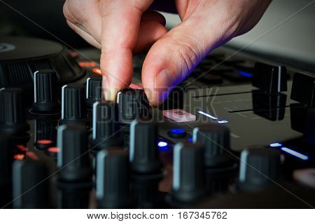 Master of sound in work with his music instrument electronic box