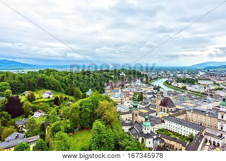 Salzburg city from the Hohensalzburg fortress. Green edge between the Historic center and nature, Austria