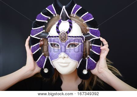 beautiful blonde girl in a theatrical mask