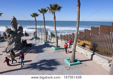 PLAYAS DE TIJUANA MEXICO - JANUARY 28 2017: The north west corner of Mexico features a beach park next to the border fence separating Mexico from the United States in Playas de Tijuana.