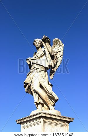 Angel statue and blue sky, Castel Sant'Angelo, Rome, Italy