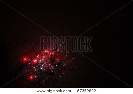 Red explotions of fireworks so beautiful at New Year