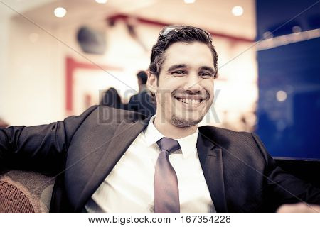 businessman taking a break in a cafe