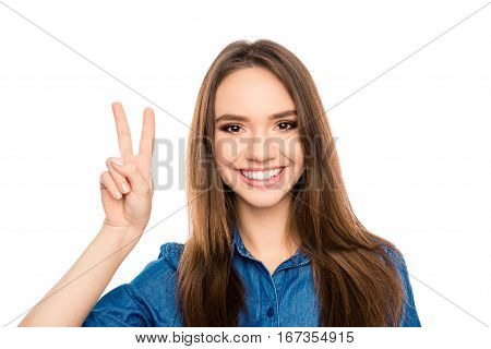 Portrait Of Cheerful Happy Brunette Woman Showing Two Fingers