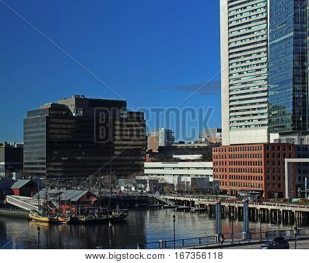 Boston, MA - December 3, 2016 - Boston Harbor with the Boston Tea Party Museum and Financial District