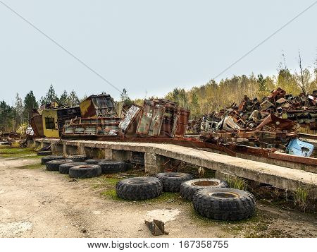 Scrap yard in the Chernobyl Exclusion Zone with old military vehicles and other scrap that was disposed after the nuclear disaster