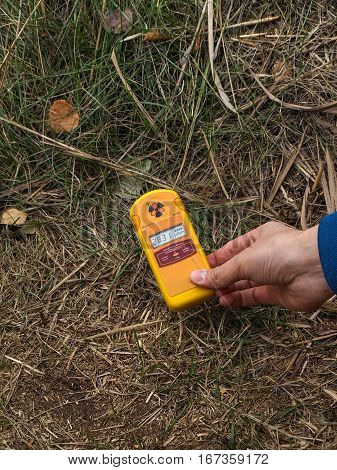 Dosimeter showing higher radiation in front of the Red Forest in the Chernobyl Exclusion Zone which was established after the nuclear disaster in 1986