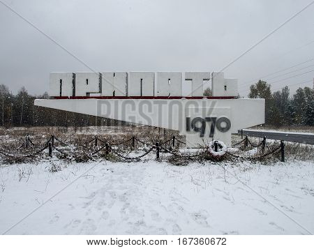 Town sign of the abandoned city of Pripyat in the Ukraine the city is located in the Chernobyl Exclusion Zone which was established after the nuclear disaster
