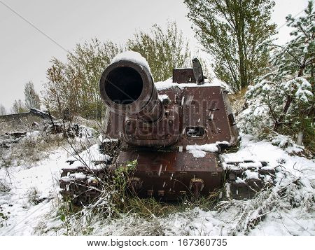 Old military vehicle (tank) in the Chernobyl Exclusion Zone that was disposed after the nuclear disaster