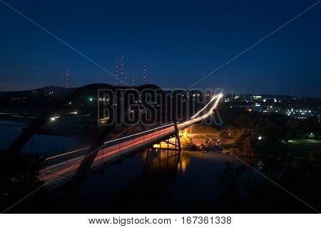 A timelapse view of an Austin Texas landmark the 360 Pennybacker Bridge at night.
