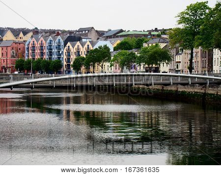 A row of colorful buildings near a bridge over the quay in Cork Ireland.