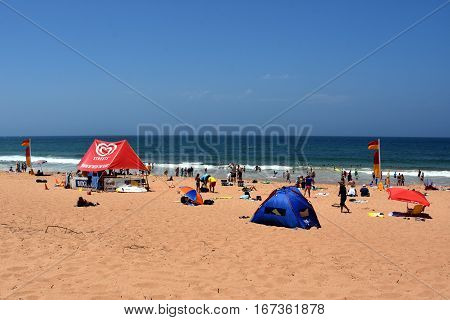 Sydney Australia - Jan 29 2017. People relaxing at the beach on a hot sunday in summer time. Newport beach Sydney NSW Australia.