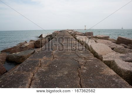 A pink granite jetty juts into the sea at the Gulf of Mexico in Texas.