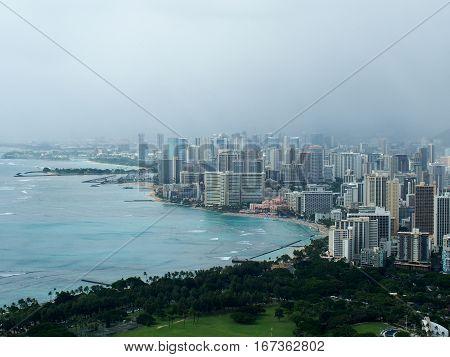 Aerial view of coast of Honolulu Hawaii on a foggy day.