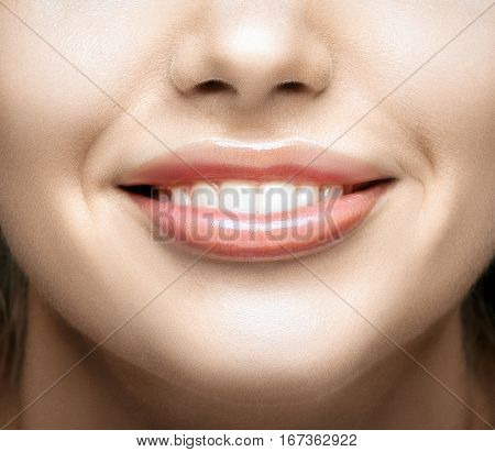Healthy woman teeth and smile. Teeth whitening. Dental care.