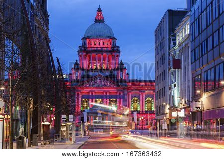 Illuminated Belfast City Hall at evening. Belfast Northern Ireland United Kingdom.