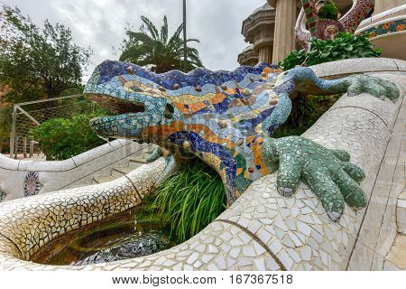 Barcelona, Spain - November 24, 2016: Dragon Stairway in Park Guell in Barcelona Spain is a public park system composed of gardens and architectonic elements located on Carmel Hill in Barcelona Catalonia (Spain).