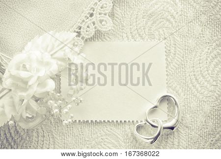 wedding invitation valentine day concept monochrome card with a clothes detail lace boutonniere two silver heart pendant