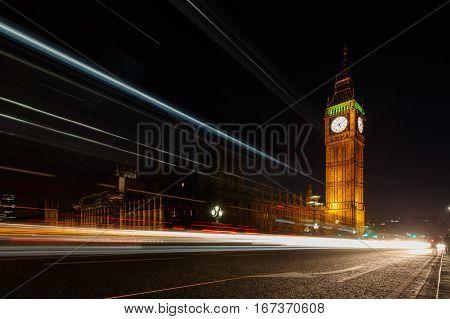 Light trails along Big Ben Parliament London England UK