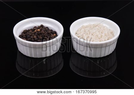 Course Gray Salt And Peppercorns S In Smal Ramekins On Reflective Black Surface