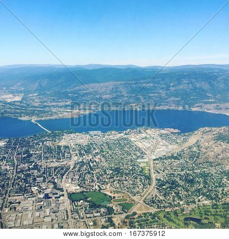 Aerial view of Kelowna BC in summer with bridge over Okanagan Lake to West Kelowna.