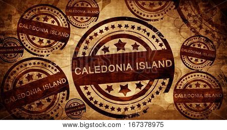 Caledonia island, vintage stamp on paper background