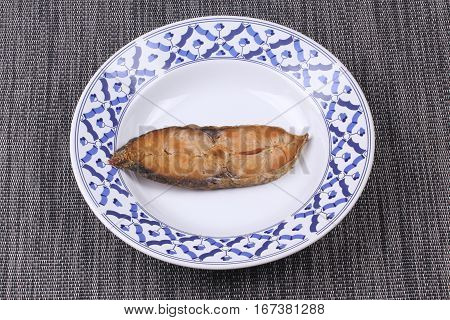 Deep-fried Dried Salted Spotted Mackerels In Thai Pattern Dish.