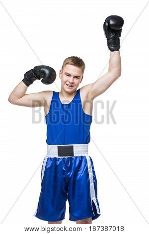 Young handsome boxer sportsman in blue boxer suit and black gloves standing on white backgound. Isolated. Copy space.