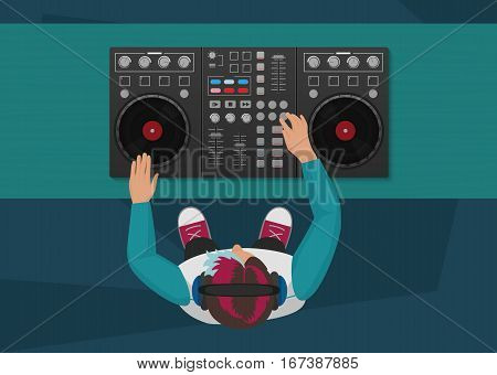 DJ playing vinyl. Top view. DJ Interface workspace mixer console turntables. Night club concept. DJ young man