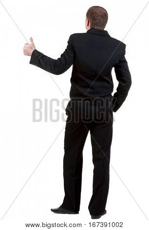 back view of business man thumbs up. rear view. Isolated over white . Rear view people collection. backside view of person. Isolated over white background.