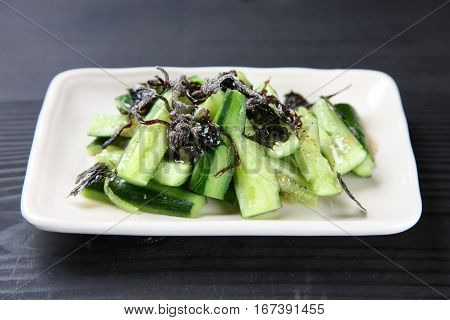 studio shot of cucumber with salt kelp