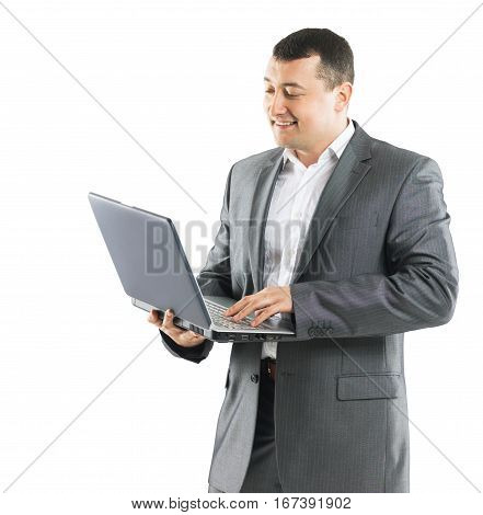 Business man with a laptop on a white background is exploring methods to promote products