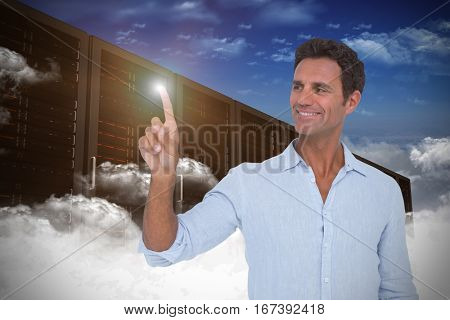 Man pointing at something on white background against data center with background effects Handsome man pointing at something on white background