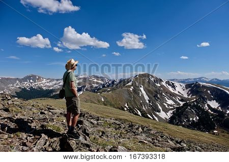 Man hiker in alpine tundra at Independence Pass. Denver. Aspen. Colorado. United States.