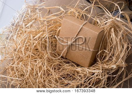 Gift Box Of Brown Color On A Straw Background