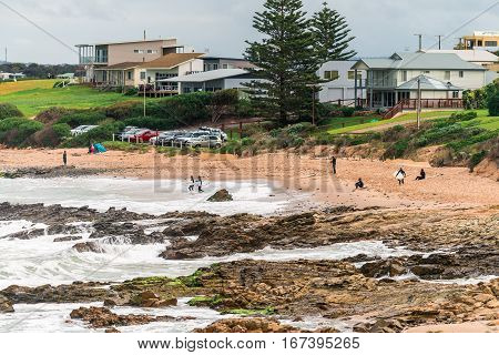 Adelaide Australia - August 14 2016: Surfers entering the water at Middleton beachfront