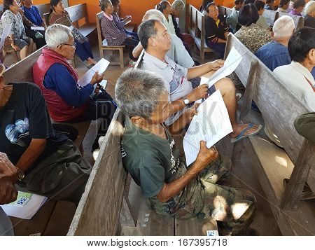 CHIANG RAI THAILAND - DECEMBER 19 : Unidentified asian old people suffering from leprosy reading and waiting for treatment on December 19 2016 in Chiang rai Thailand.